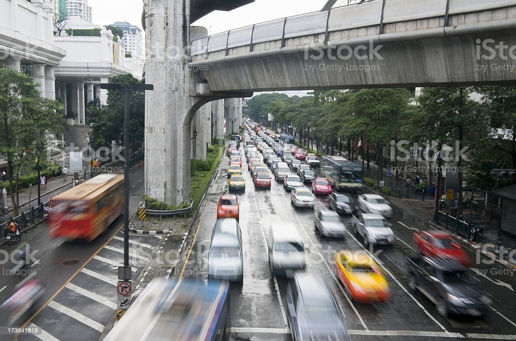 Traffic On Ratchadamri Road Under The Sky-Train In Bangkok, Thailand royalty-free stock photo