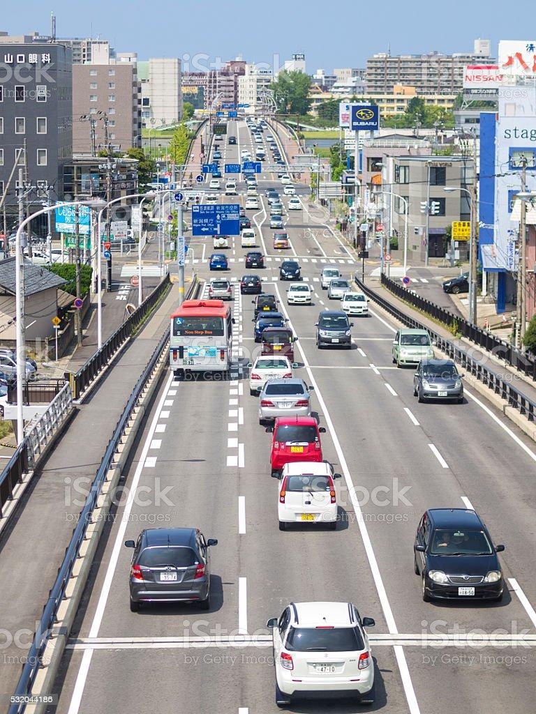 Traffic on road approaching Niigata, Japan stock photo