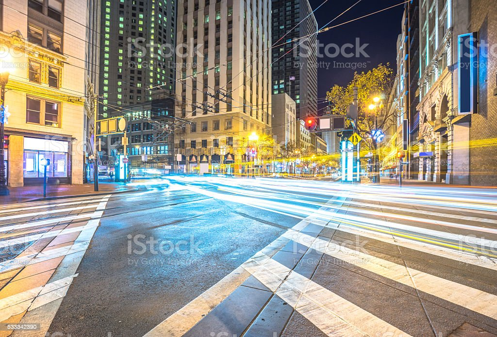 traffic on road intersection at night in san francisco stock photo