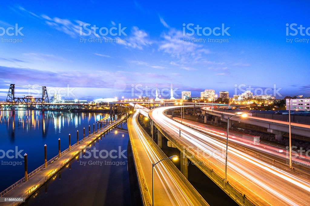 traffic on road with cityscape and skyline of portland stock photo