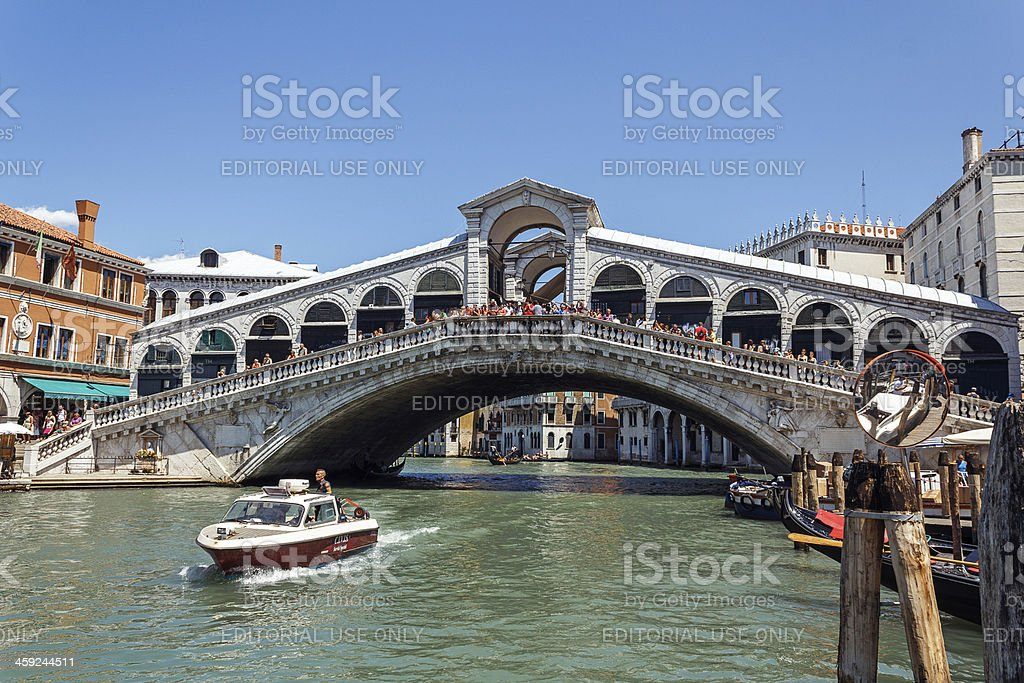 traffic on the Grand Canal under Ponte di Rialto royalty-free stock photo