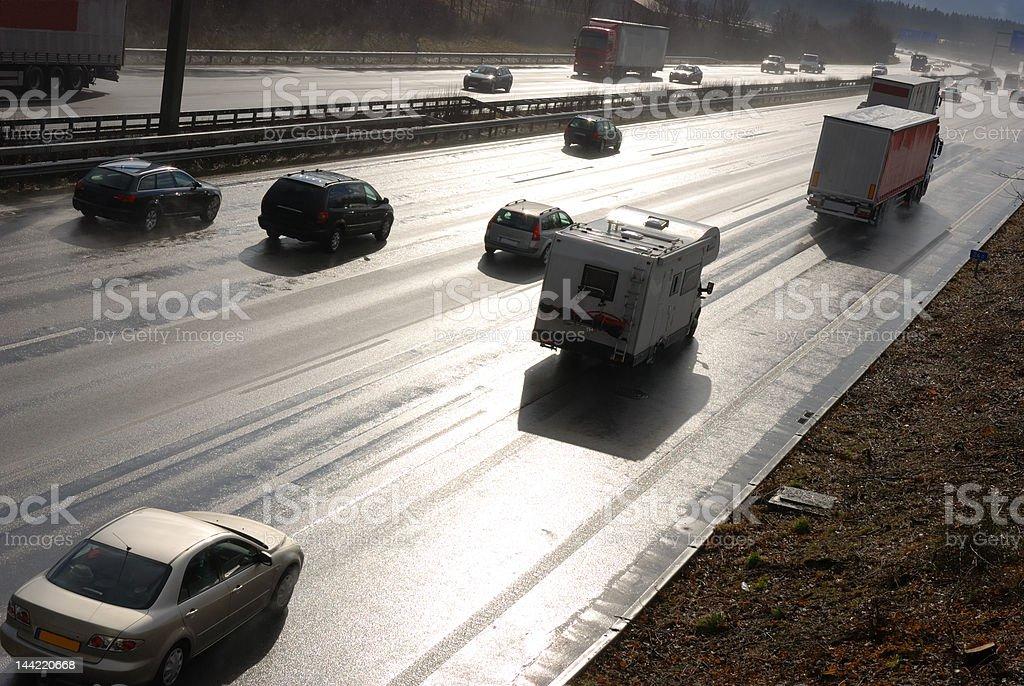 traffic on wet multiple lane highway (german autobahn), back lit stock photo