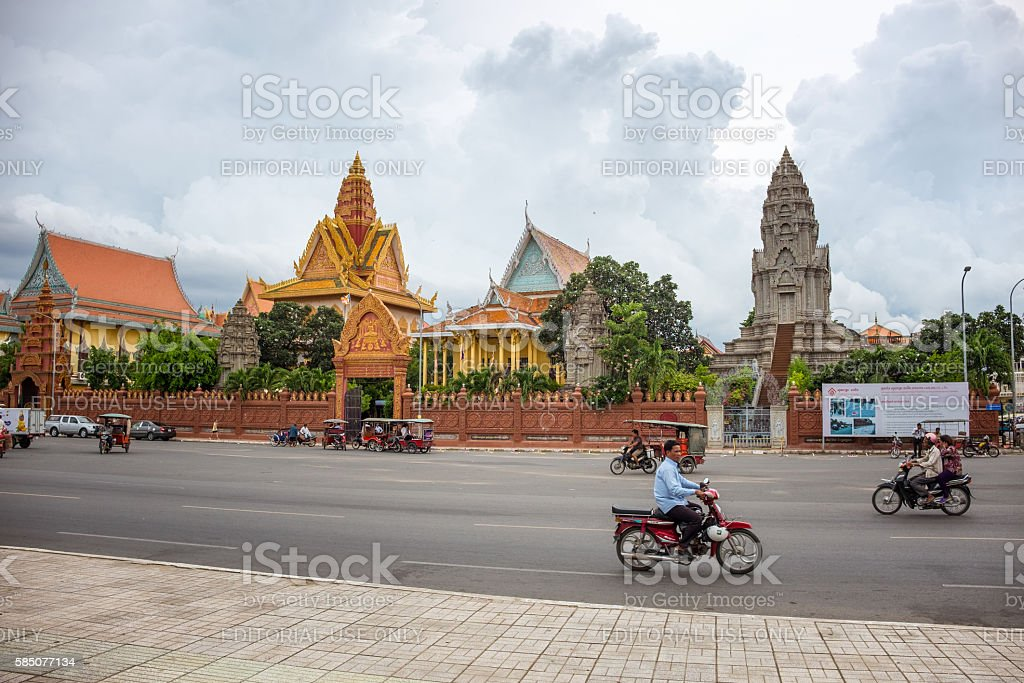 Traffic Outside Wat Ounalom In Phnom Penh, Cambodia stock photo
