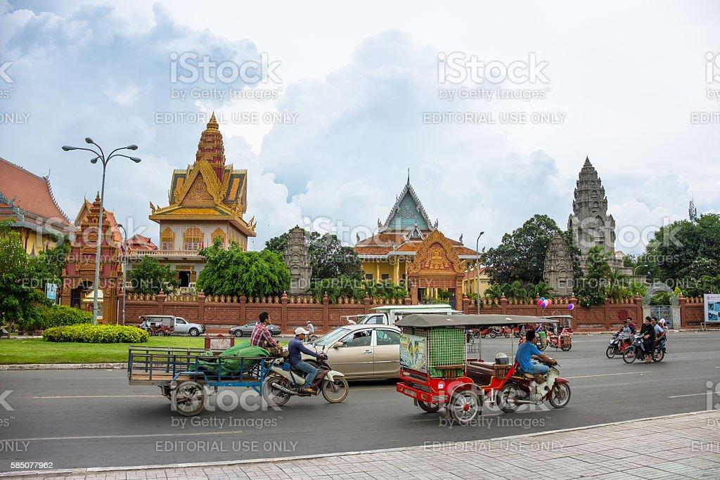 Traffic Outside Wat Ounalom In Phnom Penh, Cambodia stock photo