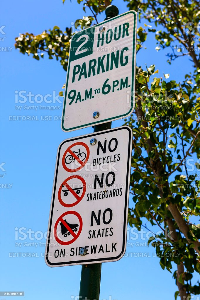 Traffic parking and city laws signpost stock photo