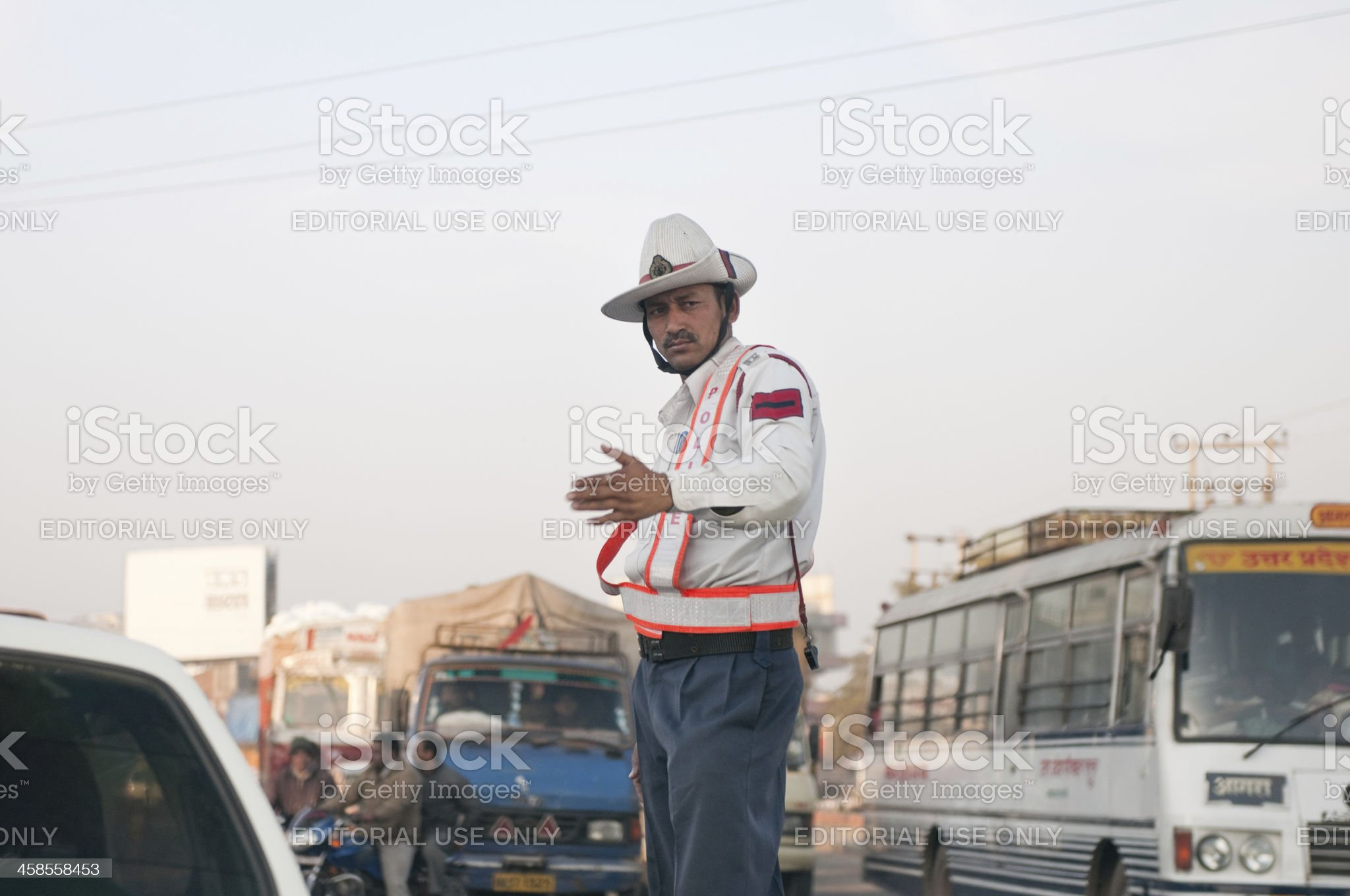 Traffic police officer waving at cars in Haryana, India royalty-free stock photo