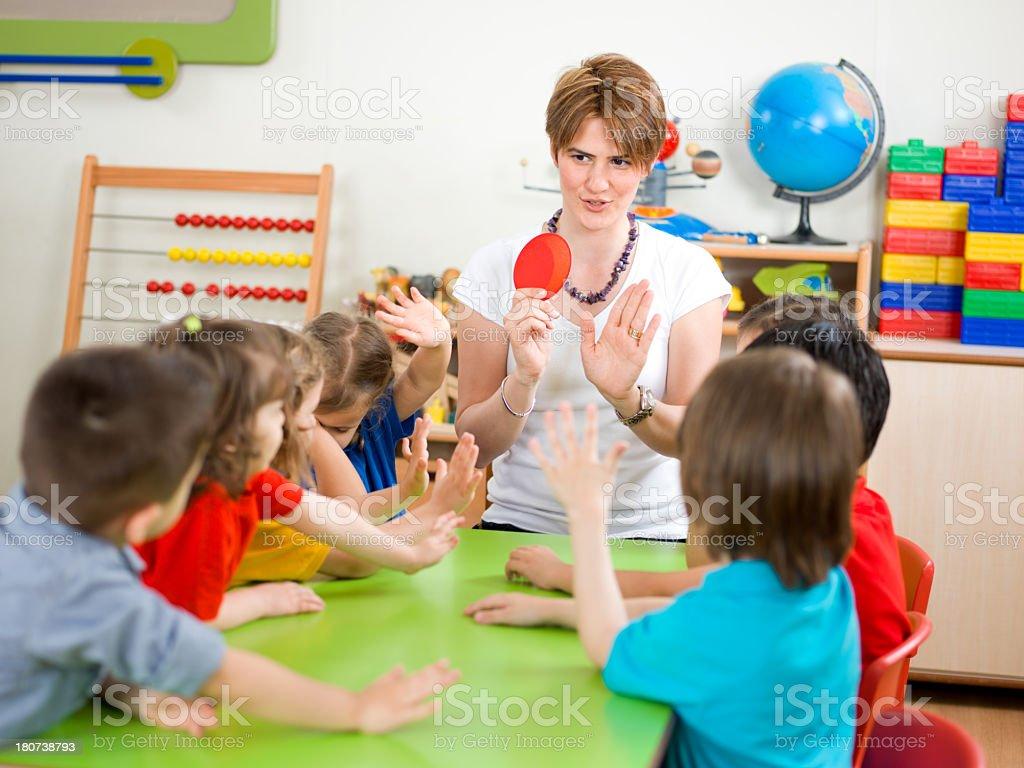 Teacher is teaching traffic regulations at students.
