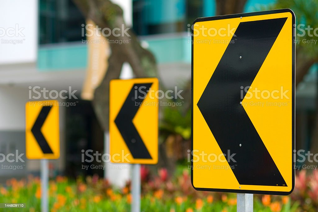 Traffic road signs - left arrows stock photo
