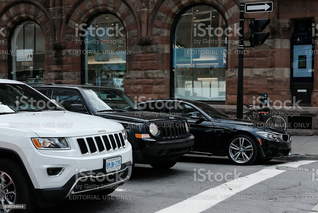 Traffic seen waiting at a city pedestrian crossing stock photo