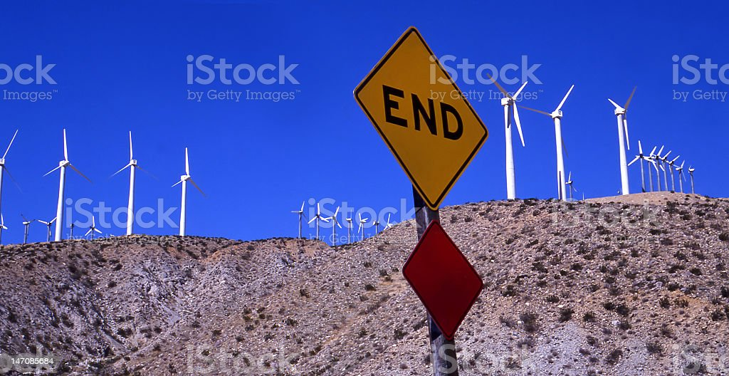 Traffic sign and windmills stock photo