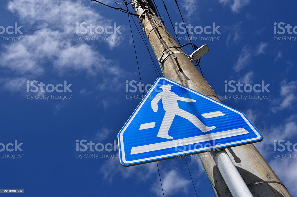 Traffic sign of the pedestrian crossing stock photo
