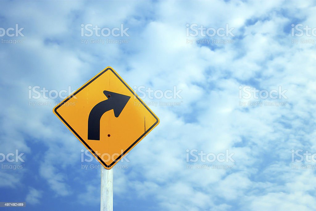 Traffic sign on the clouds stock photo
