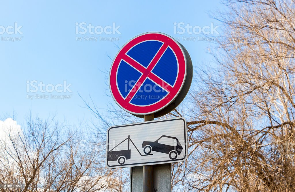 Traffic sign prohibiting parking. Evacuation on tow truck stock photo