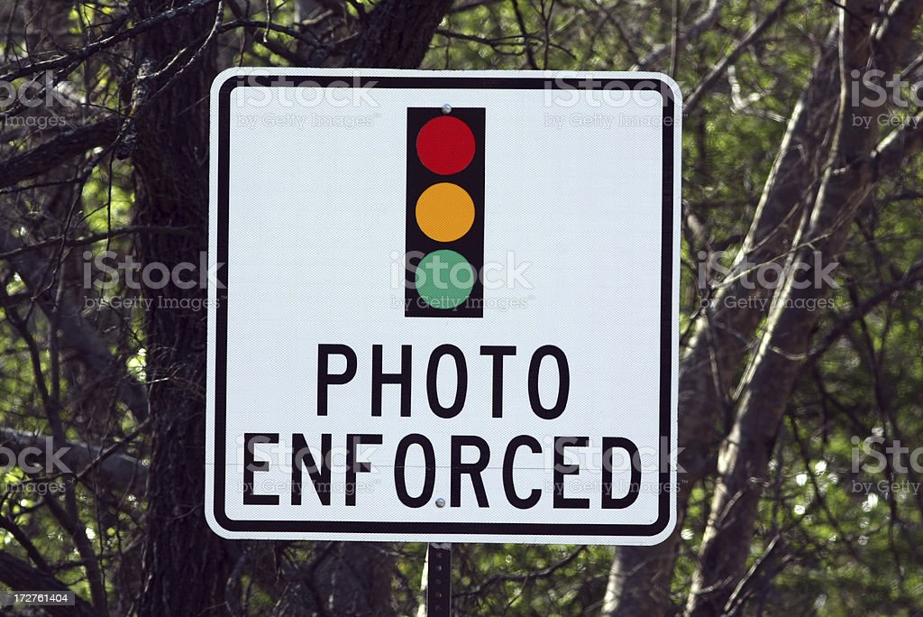 Traffic Signal Photo Enforced Sign stock photo