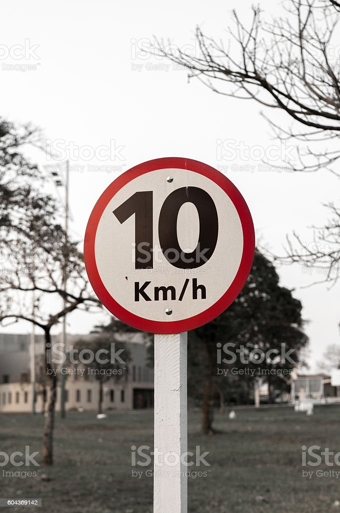 Traffic signs at a speed plate at 10 km stock photo