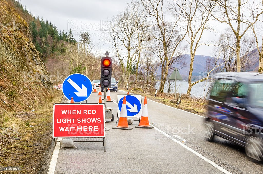 Traffic Signs at the beginning of a roadworks area stock photo