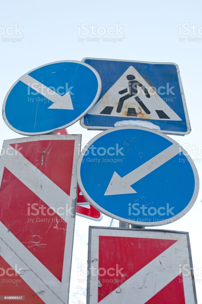 traffic signs conflict stock photo