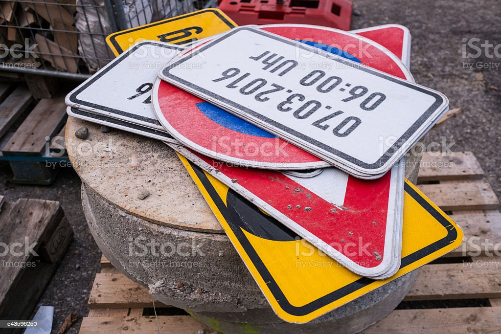 Traffic signs on a stone at a roadwork stock photo