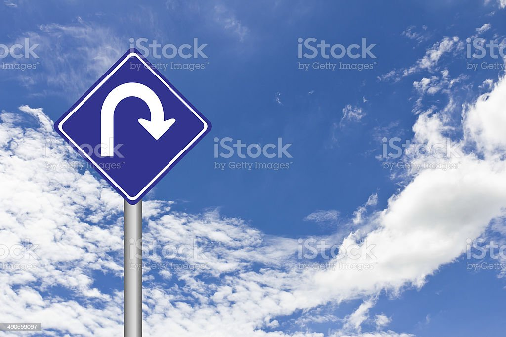Traffic Signs over blue sky,U Turn traffic sign stock photo