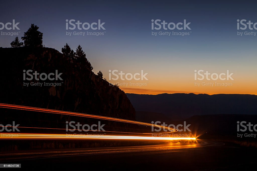 Traffic Speeding on a Mountain Road stock photo