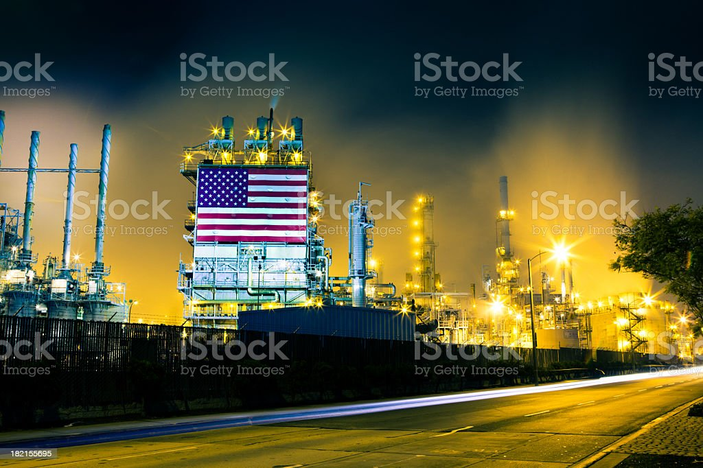 Traffic Streaks and Oil Refinery stock photo