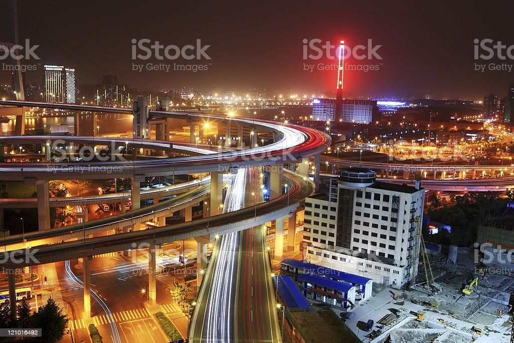 traffic through downtown at night royalty-free stock photo
