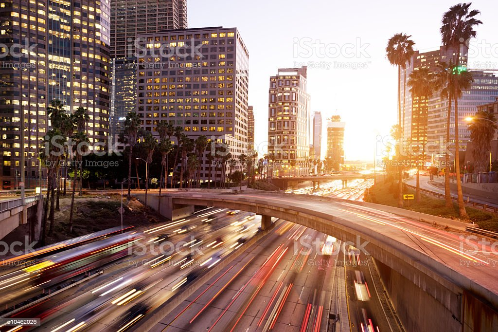 traffic through urban with sunset in los angle stock photo