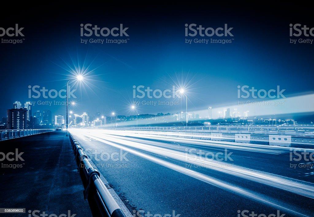 traffic trails on bridge stock photo