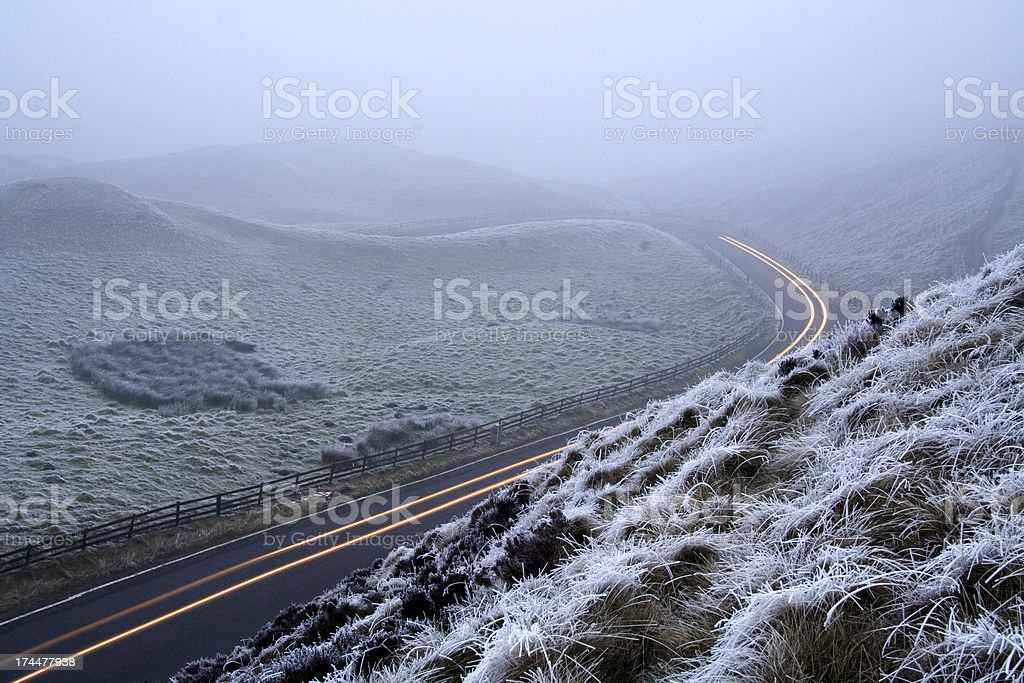Traffic Trails through Frosty Hills stock photo