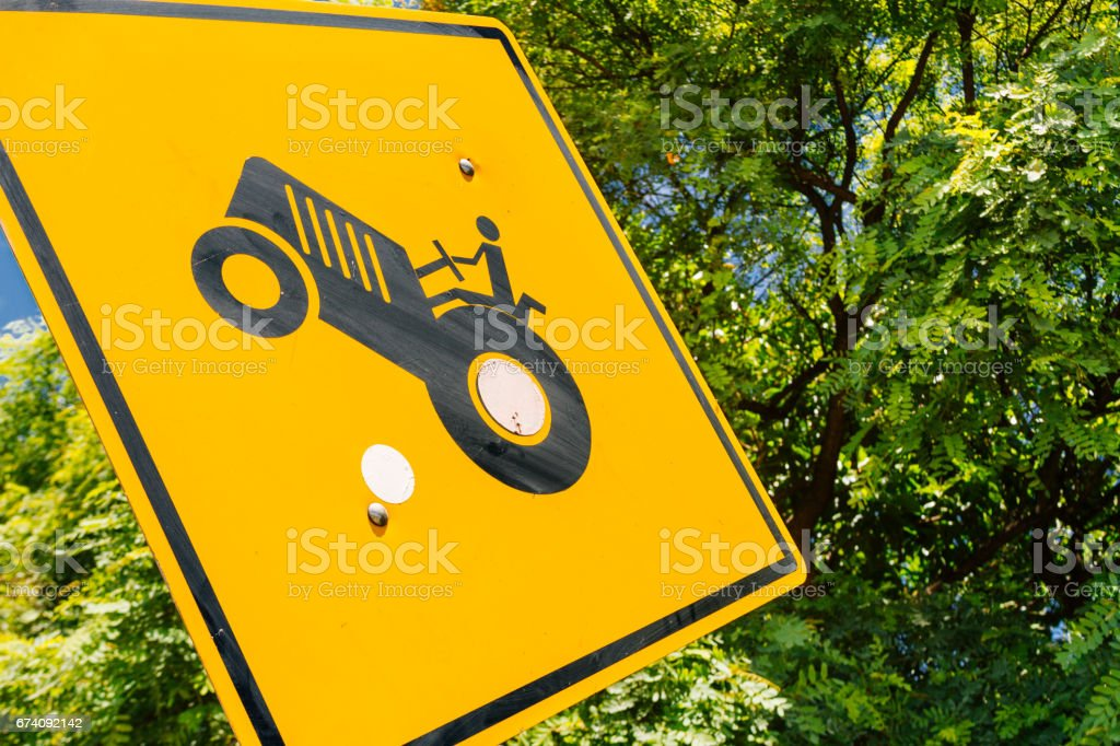 Traffic warning sign for traffic of agricultural vehicles stock photo