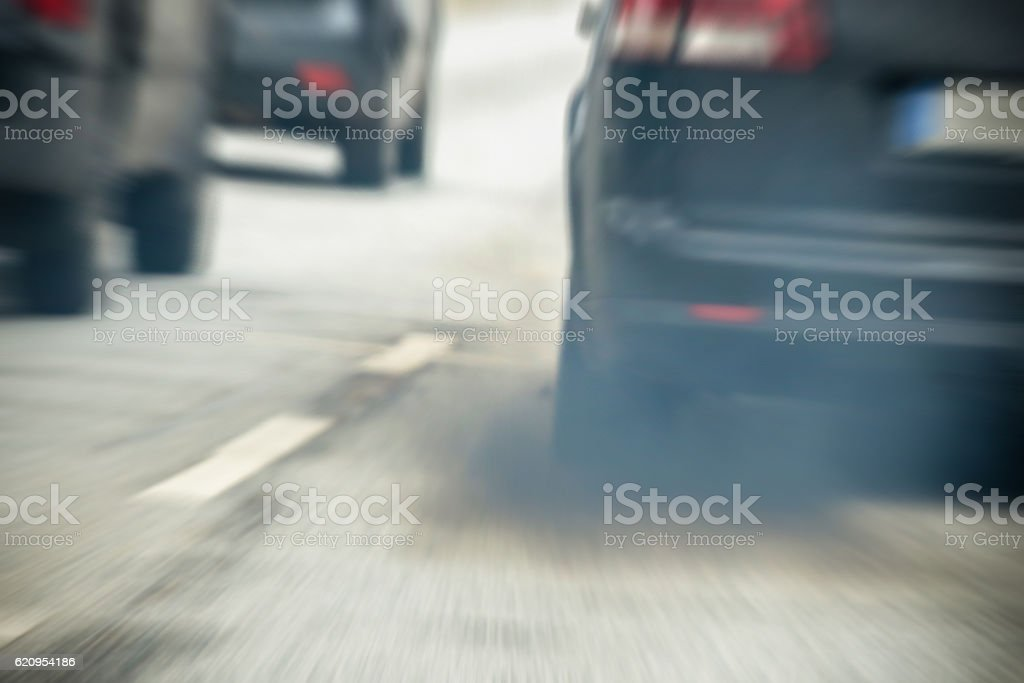 Traffic with exhaust fumes in the city stock photo