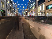 Traffic with motion blur at night on Oxford Street, London,