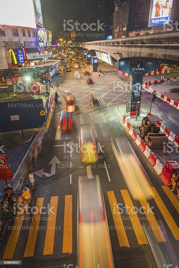 Traffic zooming through noisy neon city night Kuala Lumpur Malaysia stock photo
