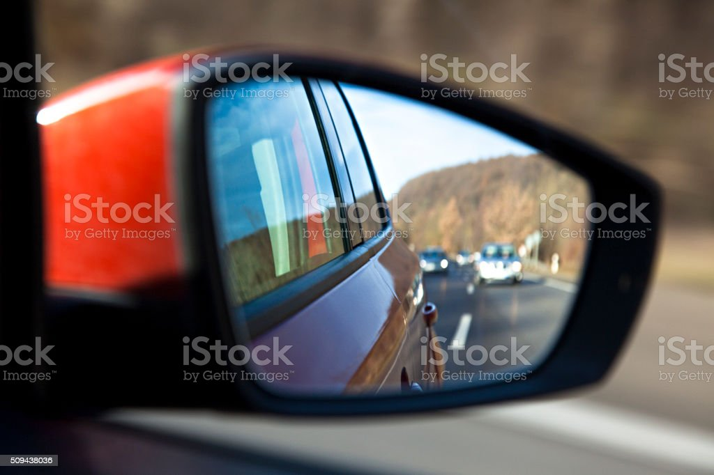 Trafic in rear view mirror stock photo