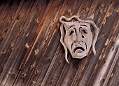 Tragedy theatrical mask on wooden background