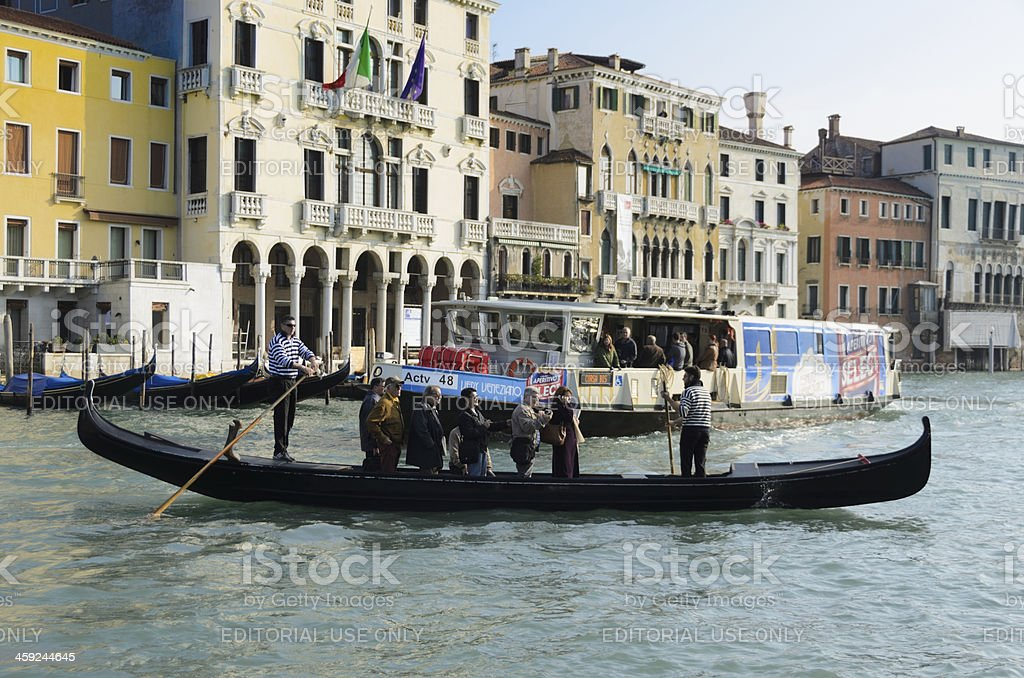 Traghetto and Vaporetto on the Grand Canal in Venice royalty-free stock photo