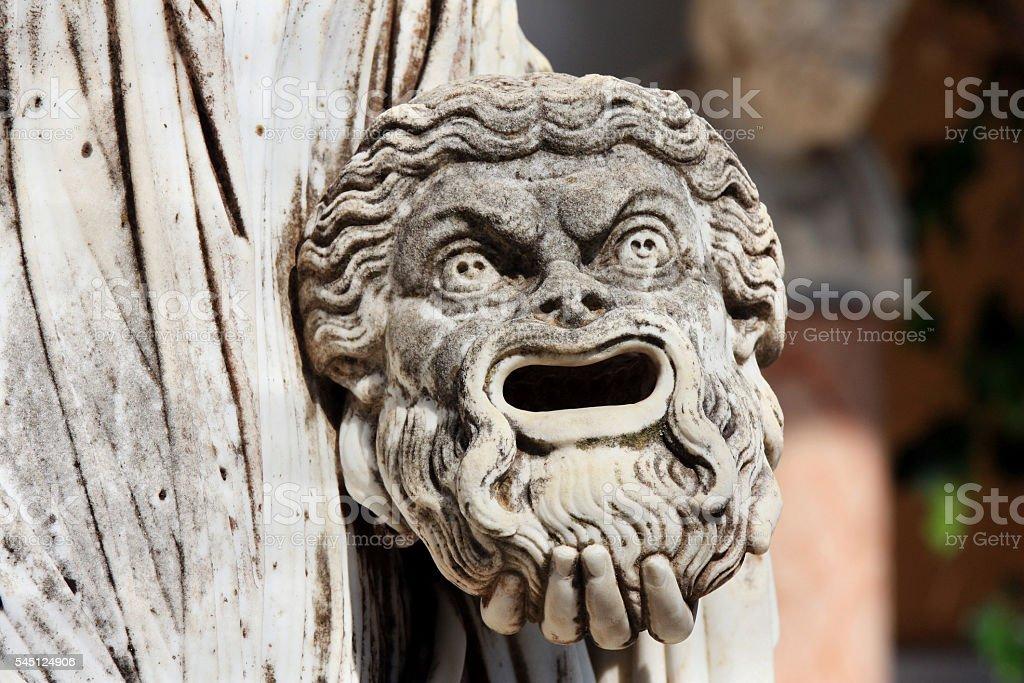 Tragic mask in hand of greek statue of Melpomene stock photo