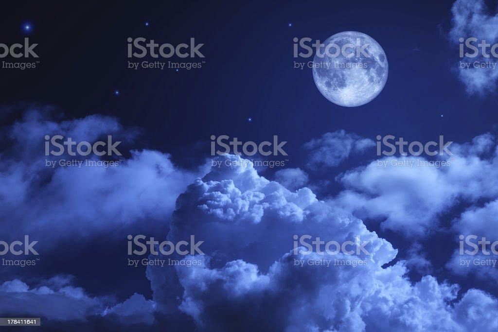 Tragic night sky with a full moon stock photo