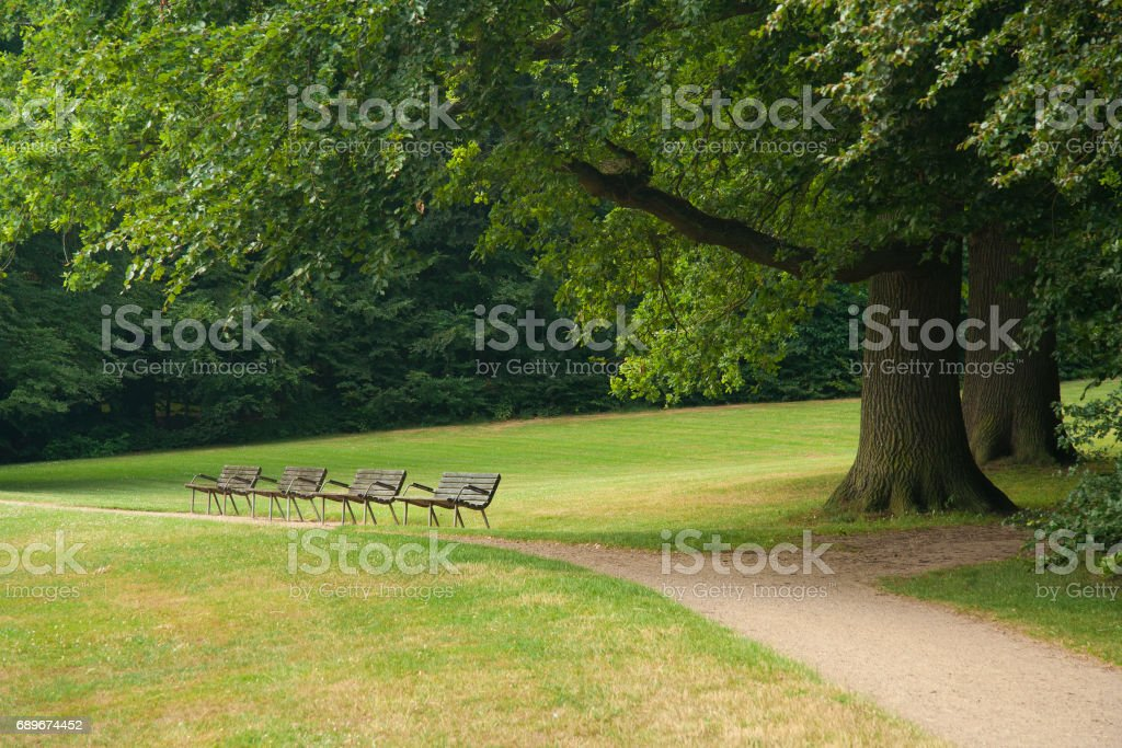 Trail and benches in Frederiksborg castle park stock photo