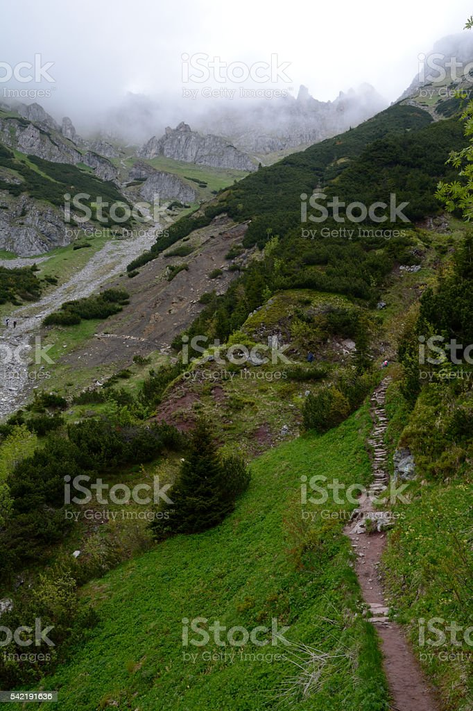 Trail and peak in clouds in Tatra mountains in Poland stock photo
