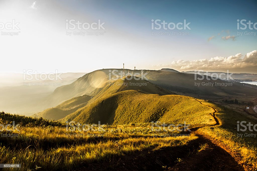 Trail at the Top of a Mountain at Warm Sunset stock photo