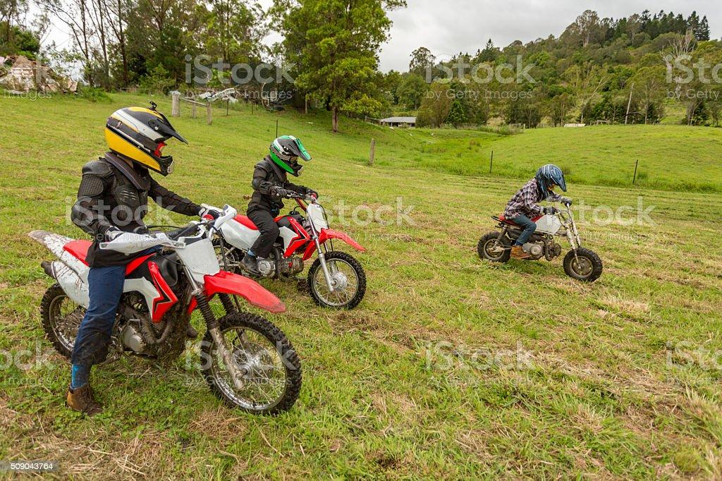 Trail Bike Riders in a Paddock on a Farm stock photo