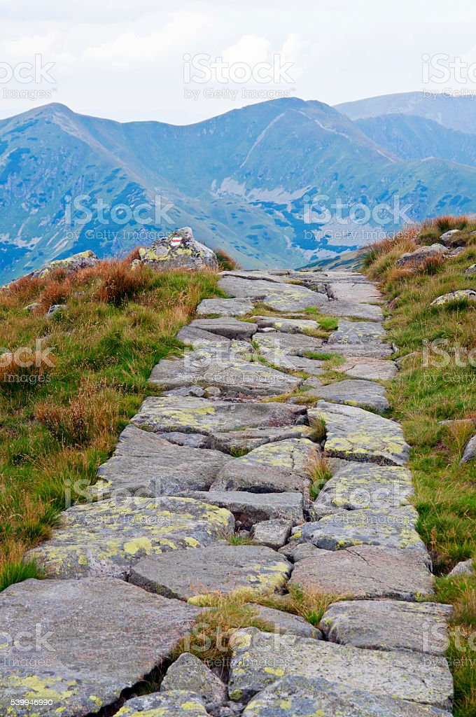 Trail disappear in high mountains stock photo