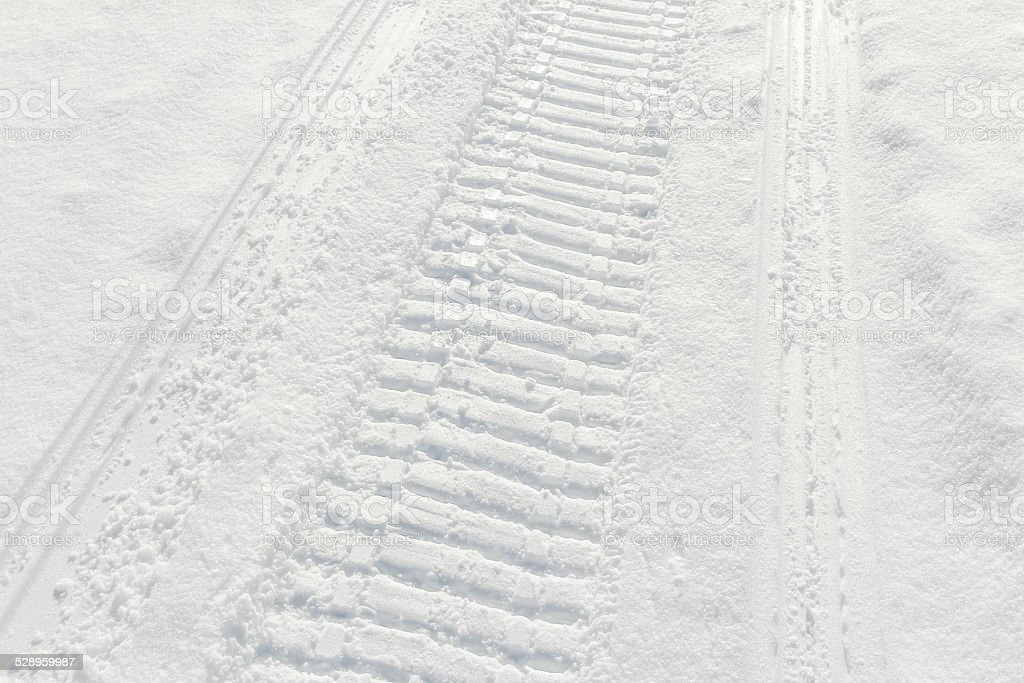 Trail of wheel in fresh snow stock photo