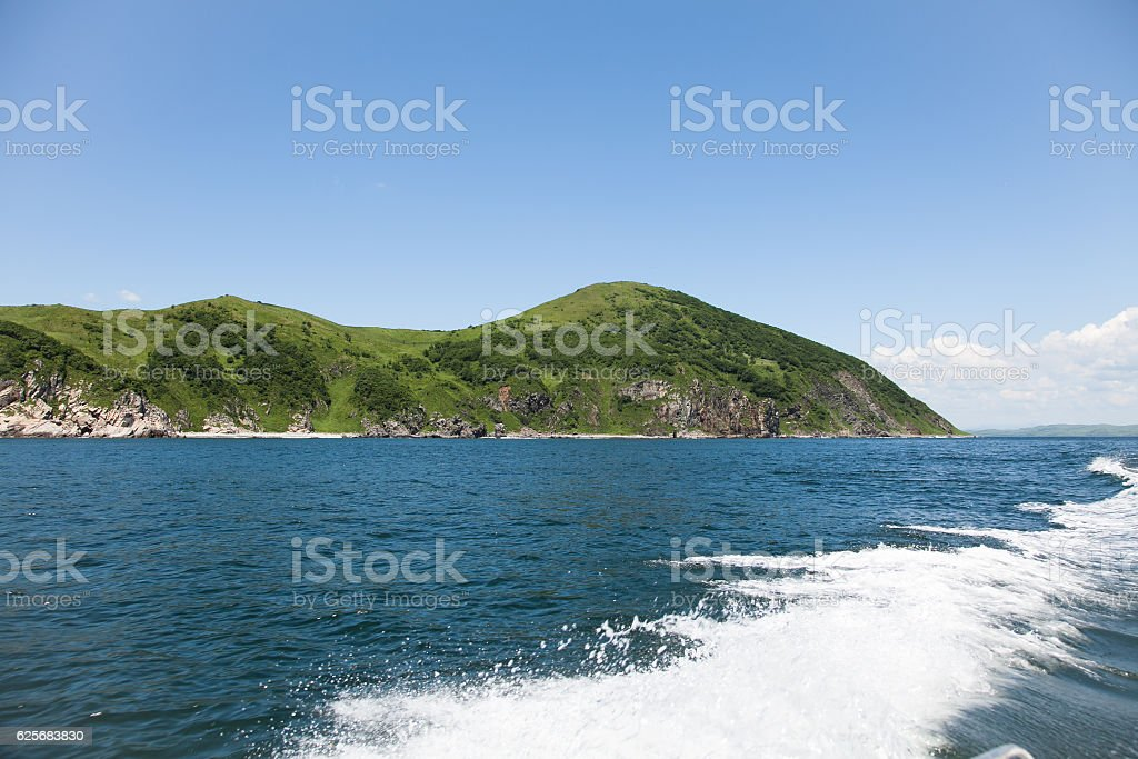 Trail on sea water surface behind boat. stock photo