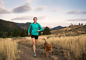 Trail Runner and Dog out for a Workout