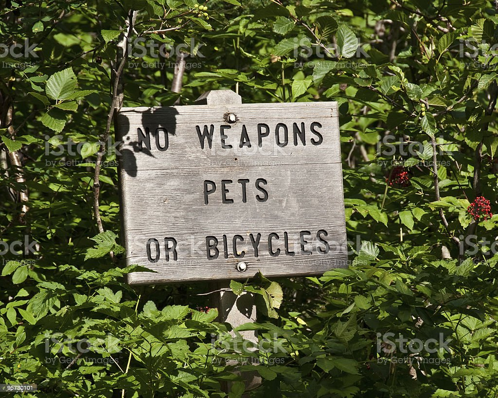 Trail Sign for Weapons, Pets and Bicycles royalty-free stock photo