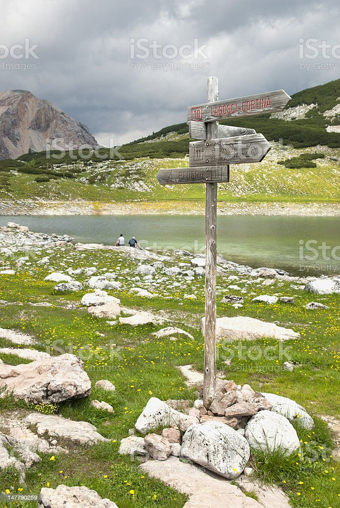 Trail Sign in the Dolomite Mountains, Italy stock photo