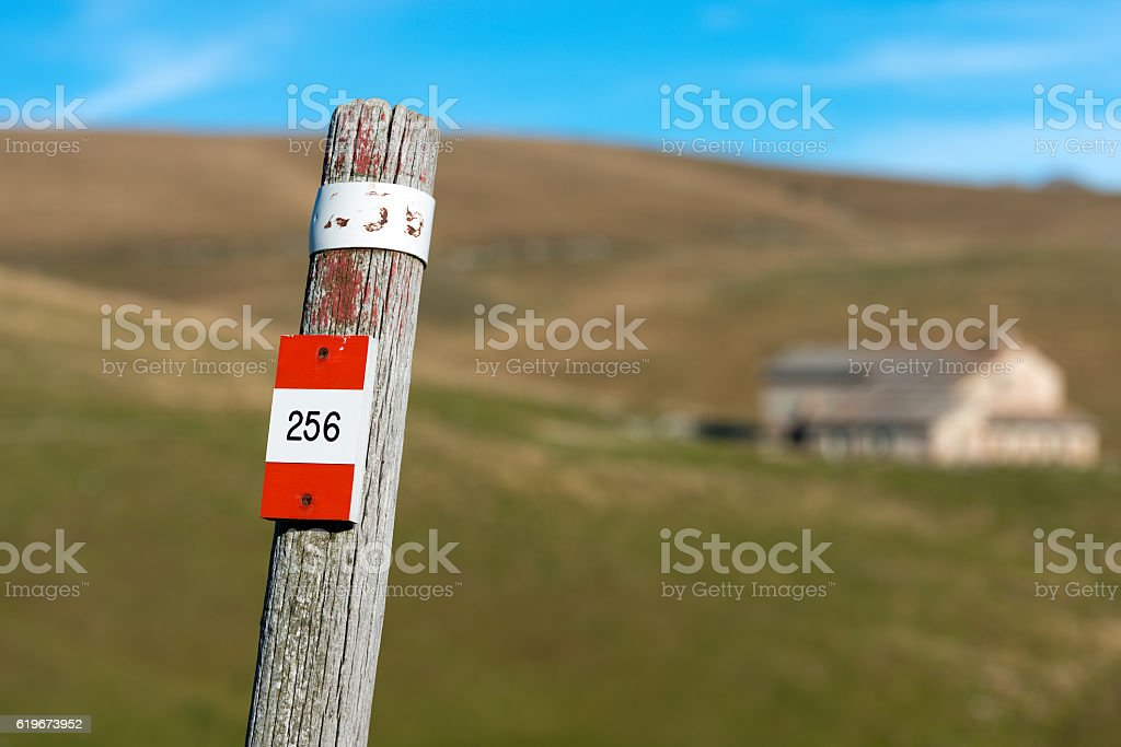 Trail Sign on a Wooden Pole - Italian Alps stock photo