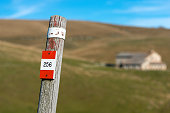 Trail Sign on a Wooden Pole - Italian Alps